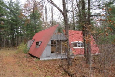 A- Frame Camp and pond on hunting land for sale