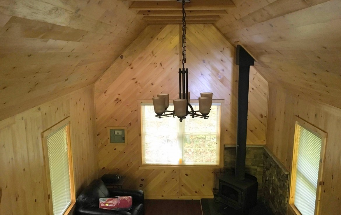 no running water or septic, there is a cozy outhouse and it's wired for a generator.