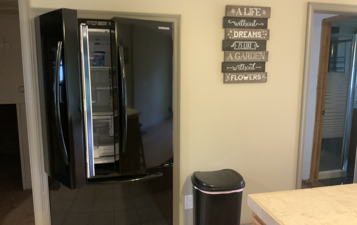 Modern up to date kitchen with new appliances and breakfast bar.