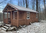 Large Amish shed wired with electric for storing ATV, snowmobile, hunting/ fishing supplies.