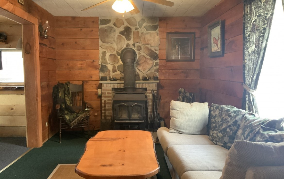 Family room with large wood stove.