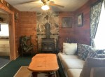 Family room with large wood stove.k